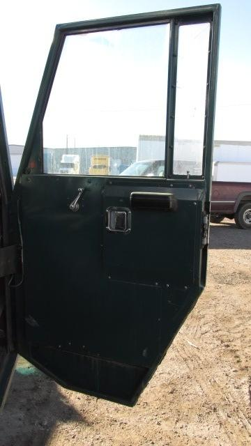 CRANE CARRIER DR Door Assembly, Front